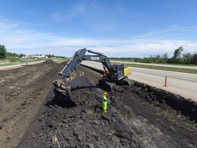 Excavator Digging - Road Construction Services - Iron Pine Contracting, Grande Prairie